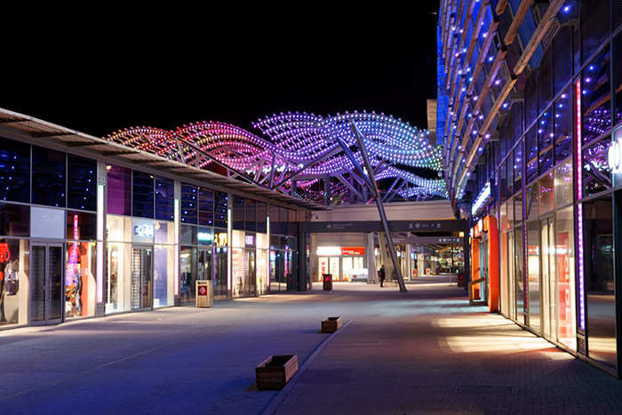 The outstanding entrance of Carré de Soie Shopping Mall illuminated by Philips Lighting and Axente