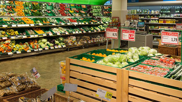A well-stocked fresh fruit and vegetables section of a German supermarket. - reduce energy cost